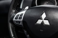 Novosibirsk, Russia - March 09, 2019: Mitsubishi Outlander. Close-up of the Multiwheel with phone setting and volume buttons. Photography of a modern car on a stock photography