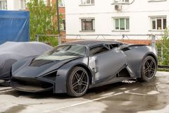 Marussia B3 front view. Photography of a Russian supercar SUV on parking. Car after crash. royalty free stock images