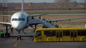 Passengers leaving plane
