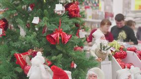 NOVOSIBIRSK,RUSSIA - November 25,2017: Sale of toys and Christmas trees until xmas. People in the supermarket are. Christmas gifts for loved ones. Christmas sale stock footage