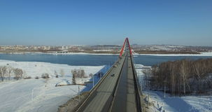 NOVOSIBIRSK, RUSSIA - November 22, 2016: Traffic on Bugrinsky bridge. NOVOSIBIRSK, RUSSIA - November 22, 2016: Traffic on modern highway through new Bugrinsky stock video footage