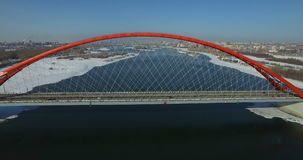 NOVOSIBIRSK, RUSSIA - November 22, 2016: Traffic on Bugrinsky bridge. NOVOSIBIRSK, RUSSIA - November 22, 2016: Traffic on modern highway through new Bugrinsky stock video
