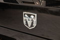 Rear nameplate and emblem on the trunk of luxury very expensive new black Dodge Ram 1500 hemi 5.7 litres car stands in the royalty free stock image