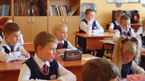 Novosibirsk, Russia - september, 1, 2015. First-grade students and teacher are in school classroom at first lesson. The stock footage
