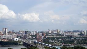 NOVOSIBIRSK, RUSSIA - View of Novosibirsk city. Timelapse. NOVOSIBIRSK, RUSSIA - View of Novosibirsk city center. Panorama of busuness city. Summer cityscape of stock video footage