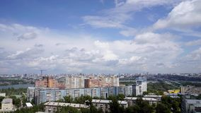 NOVOSIBIRSK, RUSSIA - View of Novosibirsk city. Timelapse 3. NOVOSIBIRSK, RUSSIA - View of Novosibirsk city center. Panorama of busuness city. Summer cityscape stock video footage