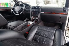 View to the interior of Porsche Cayenne 957 2007 with dashboard, clock, media system, front seats and shiftgear after cleaning stock image