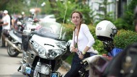 Novosibirsk 2016: Women are fond of men`s hobbies. Motofestival. Russia, Novosibirsk 2016: Moto bikers festival. Siberian Motofestival. Women are fond of men`s stock footage