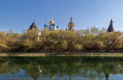Novospassky monastery in Moscow, Russia. Battlement bell tower and temple of the monastery Novospassky. General view of the waterfront. Moscow, Russian Stock Images