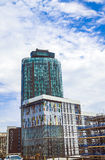 Novotel London West and modern buildings on cloudy sky background Stock Images