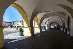 Novy Jicin, Czech Republic. Arcades in old market square. 06 May 2018, Novy Jicin, Czech Republic. Old market square in Novy Jicin with Church of the Assumption Royalty Free Stock Images