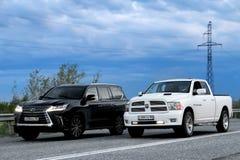 Lexus LX570 and Dodge Ram 1500 Stock Photo
