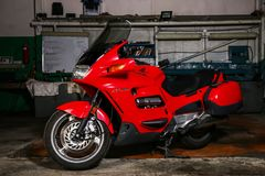 Honda ST1100. Novyy Urengoy, Russia - March 31, 2017: Red motorcycle Honda ST1100 in the car repair garage royalty free stock images