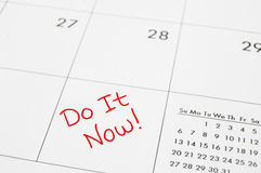 Now. Closeup of a calendar with Do It Now text royalty free stock image