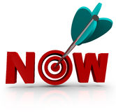 Now - Arrow Hits Bulls-Eye in Word Royalty Free Stock Images