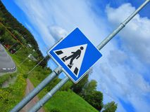 Now it certainly start to get steep. Skilt, crossing, people stock photography