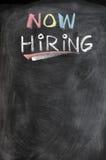 Now hiring. Blank advertising on a blackboard Stock Photos