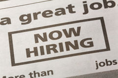 Now Hiring. Newspaper employment ad, Now Hiring, Employment concept royalty free stock images