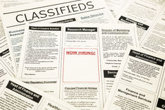 Now hiring blank ad on newspaper Stock Image