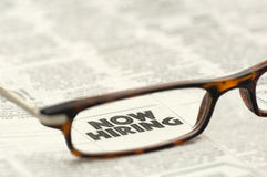 Now Hiring classified ad framed in glasses Stock Photos