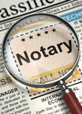 Now Hiring Notary. 3D. Notary. Newspaper with the Advertisements and Classifieds Ads for Vacancy. Magnifier Over Newspaper with Searching Job of Notary. Hiring Royalty Free Stock Photography