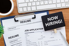 Now hiring sign for recruitment Stock Photos