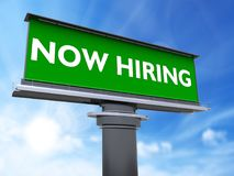 Now hiring. The words now hiring in a large billboard Royalty Free Stock Photo