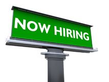 Now hiring. The words now hiring in a large billboard Royalty Free Stock Images