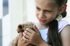 Now I have new small friend!. The girl and the puppy of a toy poodle Stock Photos