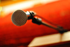Now I'll sing... Microphone in concert hall or conference room Stock Images