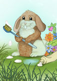 Now I`m going to brush my teeth. Bunny with toothbrush and toothpaste Stock Photo