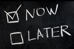 Now Later Check Boxes Handwritten Blackboard stock images