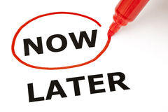 Now or Later with Red Marker. Choosing Now instead of Later, selected with red marker Royalty Free Stock Photo