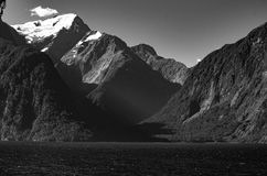 Now on the mountain. From Milford Sound in New Zealand stands the magnificent mountain. At over 2,000 metres and now throughout the year, the is a towering giant Royalty Free Stock Images