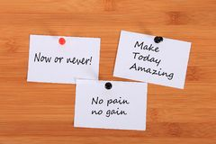 `Now or never!` `Make Today Amazing`. `No pain no gain.` Note pin on the bulletin board. `Now or never!` `Make Today Amazing`. `No pain no gain.` Note pin on royalty free stock photo