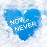 Now or never word inside love cloud blue sky only Royalty Free Stock Photo