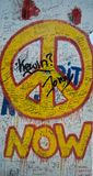 Now peace graffiti sign on the Berlin wall royalty free stock images