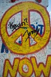 Now peace graffiti sign on the Berlin wall stock illustration