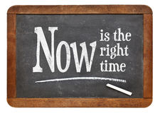 Now is the right time on blackboard. Now is the right time- motivational phrase on a vintage slate blackboard Royalty Free Stock Photo