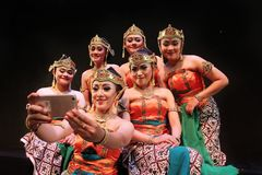 Surabaya indonesia. November 27, 2017. A group of traditional dancers are having selfies using cellphone cameras stock photo