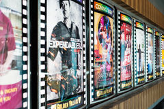 Now Showing. A choice of movie poster on the stretch of wall. Picture was taken on 08 August 2012 in a Golden Village cinema stock images