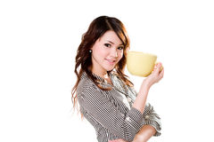 Now thats a big cup of coffee. Young woman smiling holding a big green cup Stock Photography