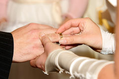 And now you're mine. Applying wedding ring for a bride for the groom Royalty Free Stock Image