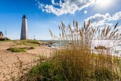 Nowa Anglia latarnia morska w latarnia morska punktu parku w Nowym przystań przeciwie Fotografia Stock