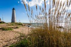 Nowa Anglia latarnia morska w latarnia morska punktu parku w Nowym przystań przeciwie Zdjęcia Stock