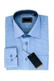 Nowa błękitnego mężczyzna koszula odizolowywająca na bielu Fotografia Royalty Free