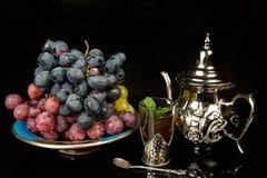 Nowa herbata i winogrona Fotografia Stock
