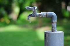 Save a Drop of Water. Nowadays, we have to save our world together. save the water. free abuse, free bad environment Royalty Free Stock Photography