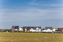 Nowe budownictwo mieszkaniowe teren w pięknym krajobrazie Obraz Stock