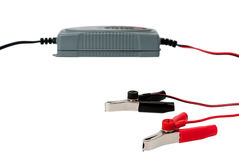 Nowożytna elektroniczna ładowarka dla samochodowej baterii z kahatami Fotografia Royalty Free
